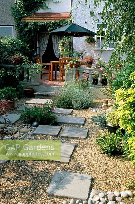 gap gardens dry gravel garden  paving slabs leading