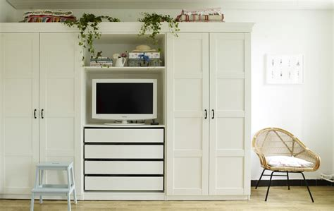 built in wardrobe storage solutions yvonne s wardrobe with built in tv cove shelves and drawers is the perfect dual solution