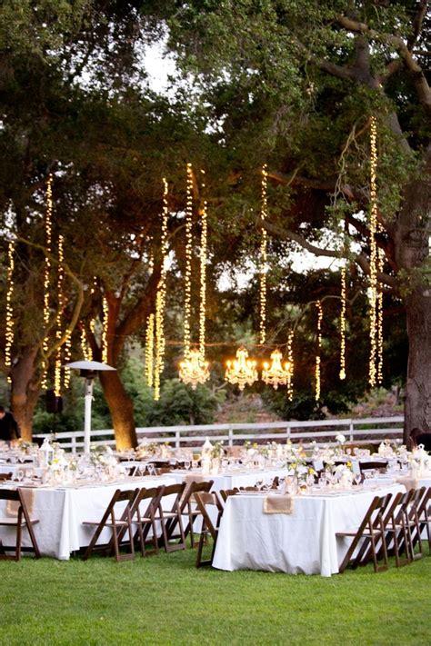 outdoor string lighting in trees wedding inspiration