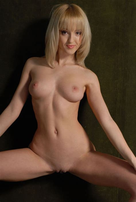 Blonde in green socks exposes boobs and shaved pussy ...
