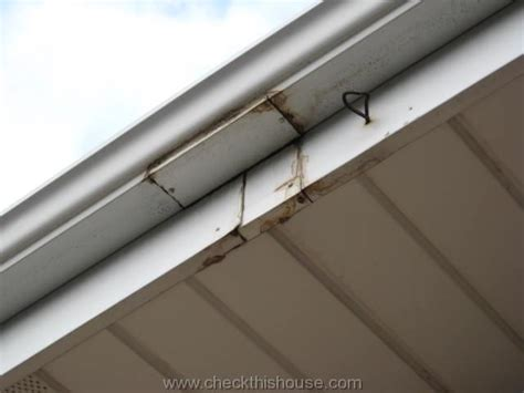 How To Clean Gutters And Other Gutter Cleaning Tips Patio Shed Roof Roofing Invoice Template Metal Vs Shingles Price Home Depot Products Repair Rakes For Snow Fick Brothers