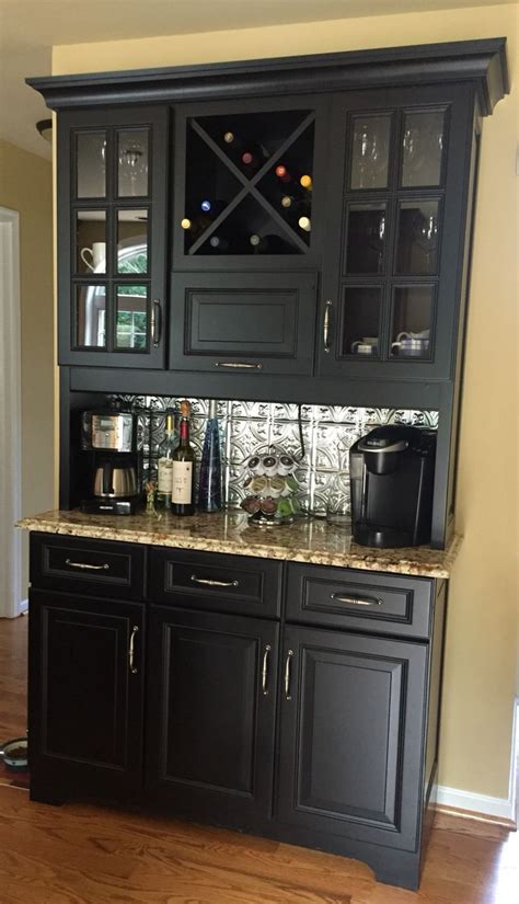 A stained oak bar countertop with exposed wine selection and coffee mugs built to feel like a separate piece of. Coffee and wine bar for the kitchen   Dining buffet, Dinning room, Kitchen