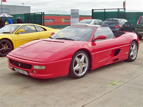It's a 355 f1 spider (which means paddle gear change) notice the badge on the back. 85 Ferrari F355 Spider (1997) | Ferrari F355 Spider (1994-99… | Flickr