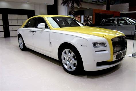 yellow rolls royce rolls royce ghost in english white and semaphore yellow