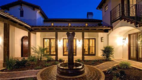 spanish hacienda mediterranean exterior austin  geschke group architecture