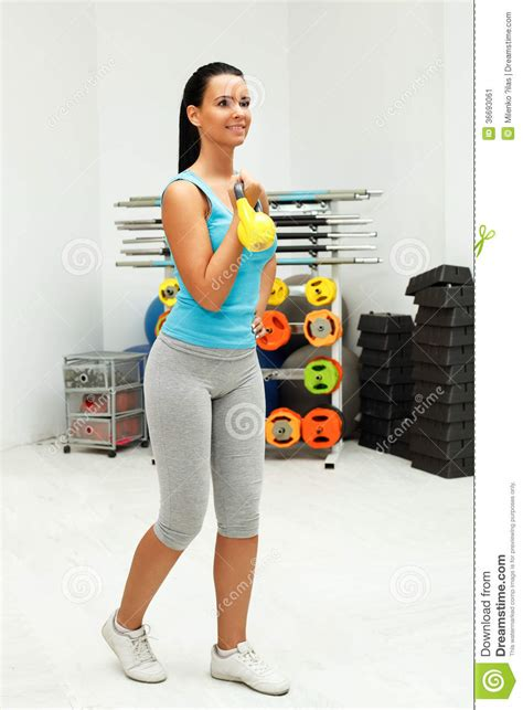 kettlebell workout exercise woman young dreamstime indoors