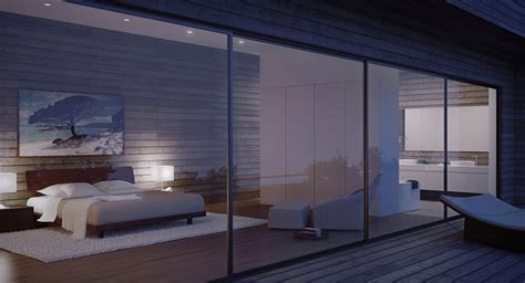 glass walled modern bedroom at night