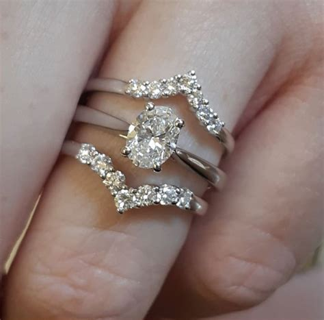 platinum oval solitaire diamond engagement ring claw set