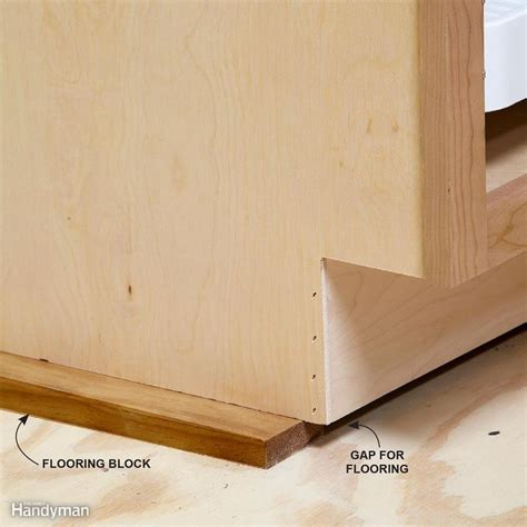 raising kitchen base cabinets how to install cabinets like a pro raising kitchens