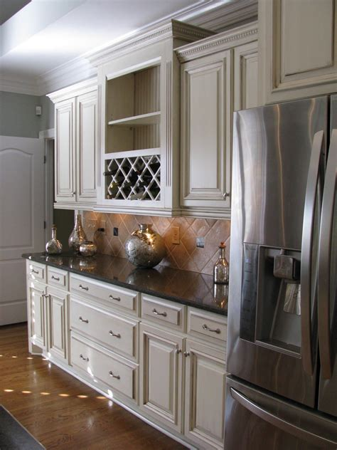 off white cabinets with brown glaze cream with chocolate glaze cabinets