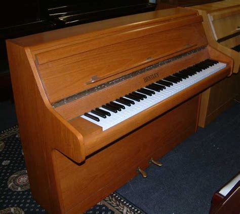English Bentley Piano For Rental In A Teak Cabinet