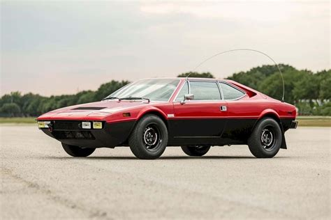 """The 308 gt4 finally gained the prancing horse badge in may 1976, which replaced the dino badges on the hood, wheels, rear panel and the steering wheel. 1975 Ferrari 308 Dino GT4 """"Safari"""" Coupe in 2020 