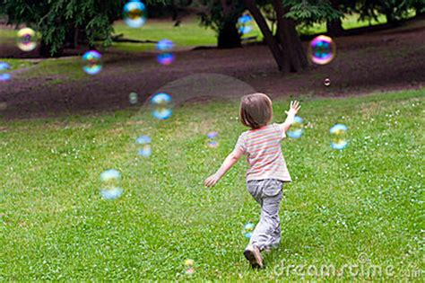 child playing  bubbles stock  image