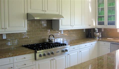 Large Glass Tile Backsplash Pictures by Chagne Glass Subway Tile Backsplash With White Cabinets