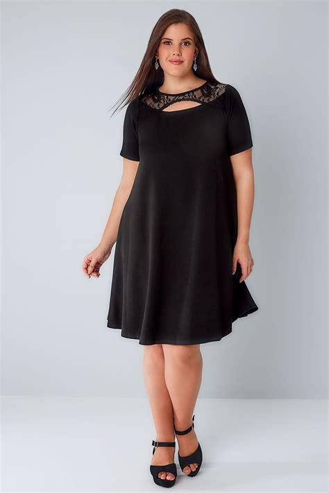 black swing dress  cut  neckline lace panel