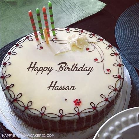 candles decorated happy birthday cake  hassan