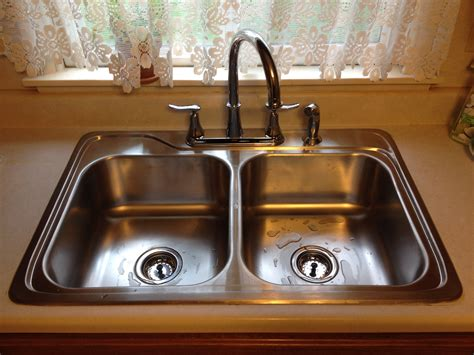 double sink clogged garbage disposal how to unclog a double kitchen sink with standing water