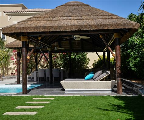 Thatched Roof House With Outdoor Entertaining Spaces by Thatched Gazebo With Seating Dining Area Outdoor