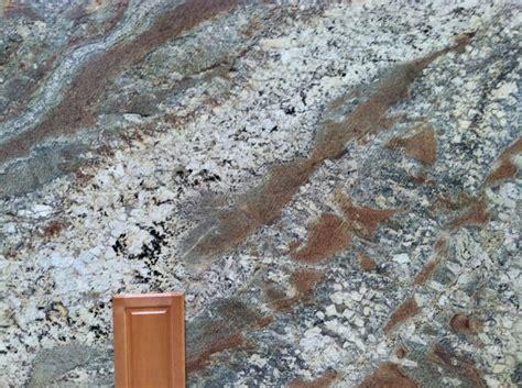 netuno bordeaux granite slab kitchen