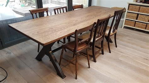 Industrial based dining tables from recycled steel and