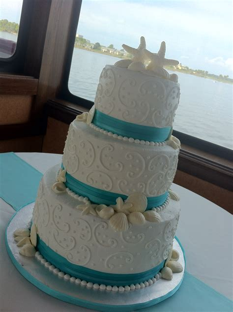 jessica  tier white wedding cake  seashells swirls