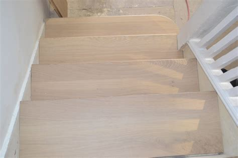 oak news light wood flooring straicase cladding  london