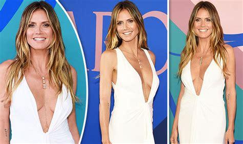 Heidi Klum Flaunts Serious Cleavage She Goes