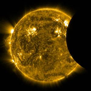 The moon crosses over a portion of the sun during a ...