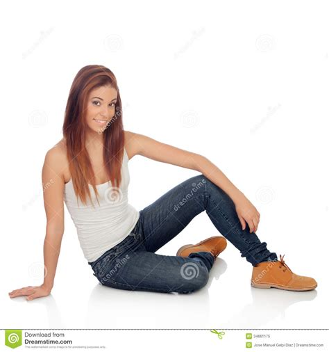 Casual Young Woman Sitting On The Floor Royalty Free Stock