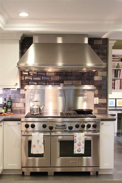 wolf 48 gas range Kitchen Farmhouse with artwork copper
