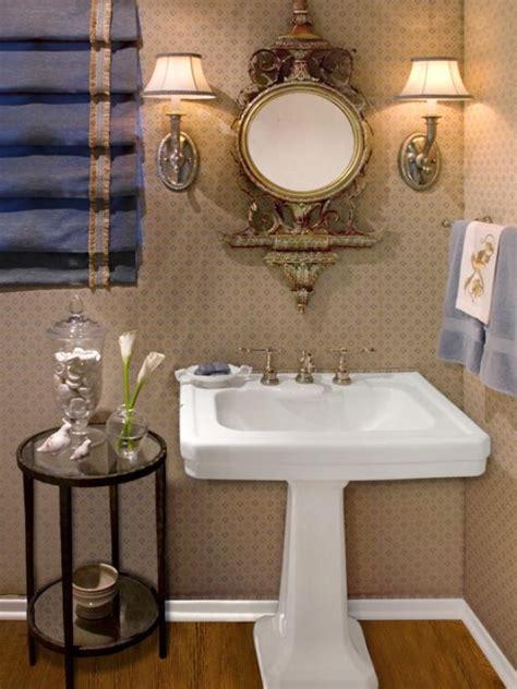 elegant powder room with stunning pedestal sink and ornate