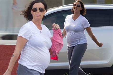 Pregnant Alanis Morissette bumps along in see-through ...