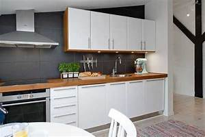 Elegant apartment ideas wrap colorful accents into white for Kitchen colors with white cabinets with vinyl wrap wall art