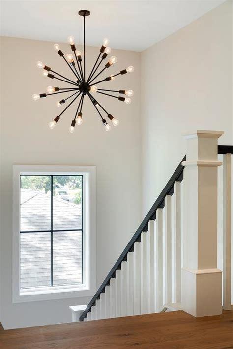 oil rubbed bronze sputnik chandelier in staircase