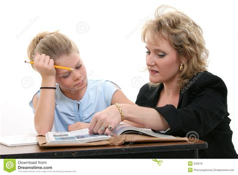 teacher helping student  desk royalty  stock images