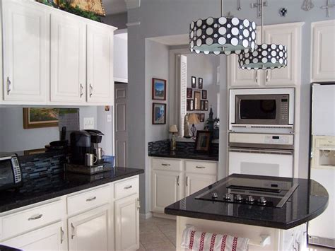 blue pearl granite  white cabinets kitchen ideas