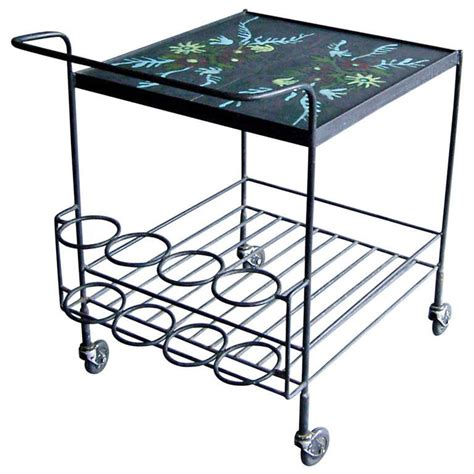 1950 s wrought iron and enameled rolling cart