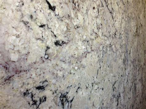 delicatus is a white granite with white offwhite creams