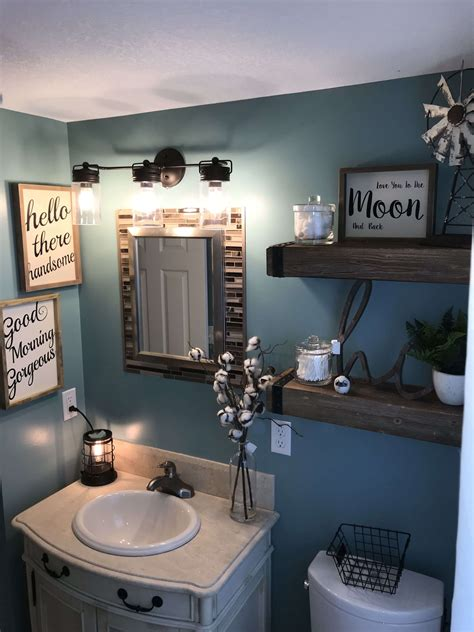 Bring in additional interest to the design with uniquely shaped mirrors and a gallery wall made up of pages from an old farmer's almanac. Top 12 Best Bathroom Wall Decor Ideas