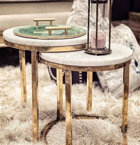 This modern coffee table in a set of 2 is designed with an elegant rounded metal frame and a genuine marble top that creates a welcoming feeling and provides ample space to put drinks or decor on top. Marble Top Nesting Table (Set of 2) - Wooden-It-Be-Nice
