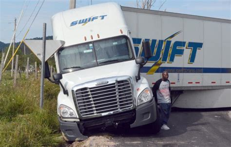 Tractor-Trailer in a Ditch | News, Sports, Jobs - The ...