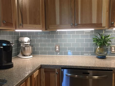 smoky blue glass tile backsplash   cabinet