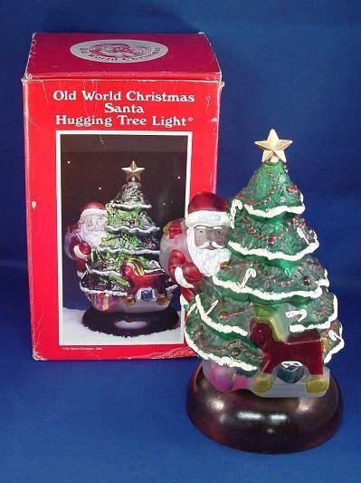 old world christmas santa hugging tree night light 1988