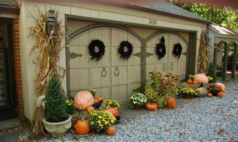 autumn outdoor decoratingpumpkins  mums  planters