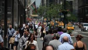 Crowd of people walking on the street in New York City ...