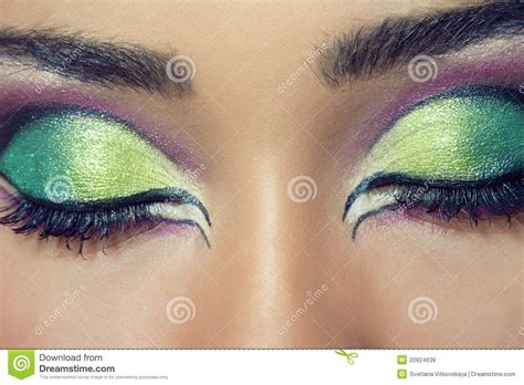 beautiful young womans face  colorful makeup stock