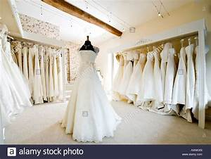 interior of wedding dress gown in bridal boutique shop With wedding dress boutique