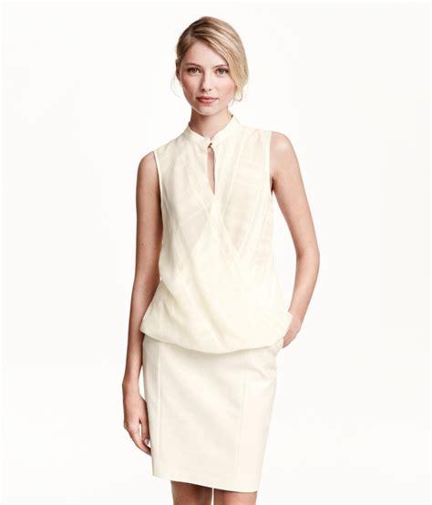 white sleeveless blouse  wrap style draped front