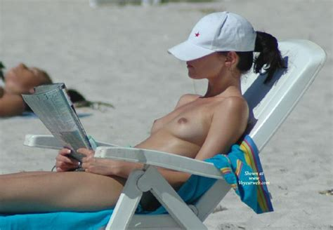 Topless Girl Reading On Beach February Voyeur Web Hall Of Fame