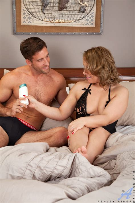 Milf Ashley Rider Takes A Virile Young Stud To Bed 1 Of 1
